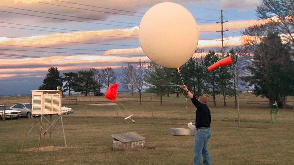 Pat Market releases a weather balloon at CAFNR's South Farm research center.