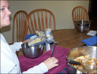 Mothers and daughters process food at home for canning