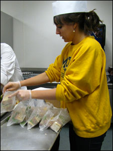 Meredith Hamilton making a sandwich