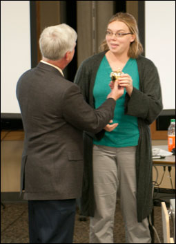 Associate Dean Bryan Garton presents Marci Crosby with the Golden Apple