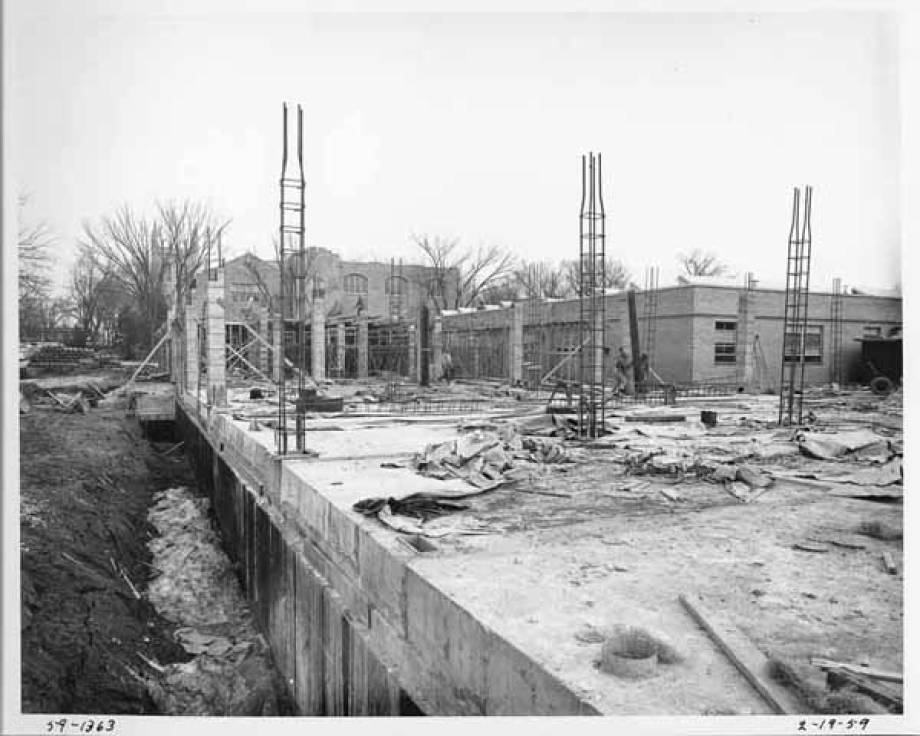 Feb. 19, 1959: Work on steel girders supporting concrete columns