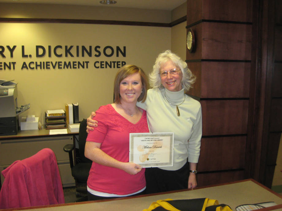 Melissa Daniels, office support staff III, Office of Academic Programs, left, is pictured with CeCe Leslie, student recruitment director. Daniels received the March Above and Beyond award from Staff Council. Thanks for all you do for CAFNR, Melissa!