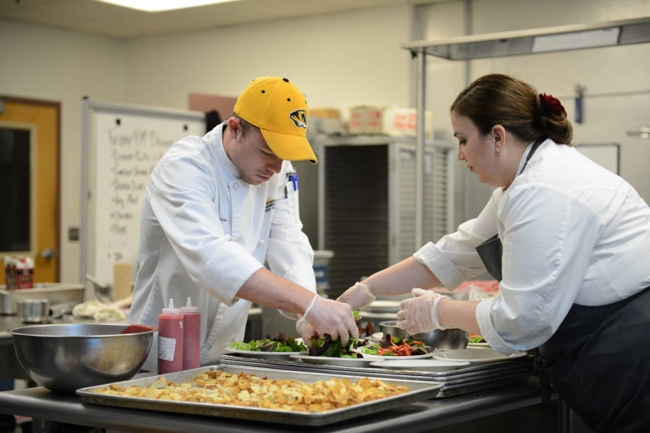 Heather Terhune, executive chef at Sable Kitchen & Bar, Chicago, and Hospitality Management alum, works with a CAFNR student to prepare her course for the Hospitality Management Gala. With help from alumni, the Gala worked to bring recognition and support to the program.