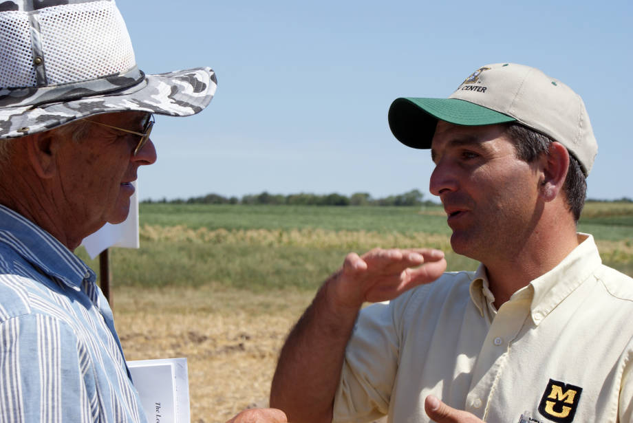 Kelly Nelson, MU research agronomist, explains the soil fertility benefits of deep lime and gypsum to a farmer at Greenley Memorial Research Center's Field Day, Tuesday, Aug. 7.