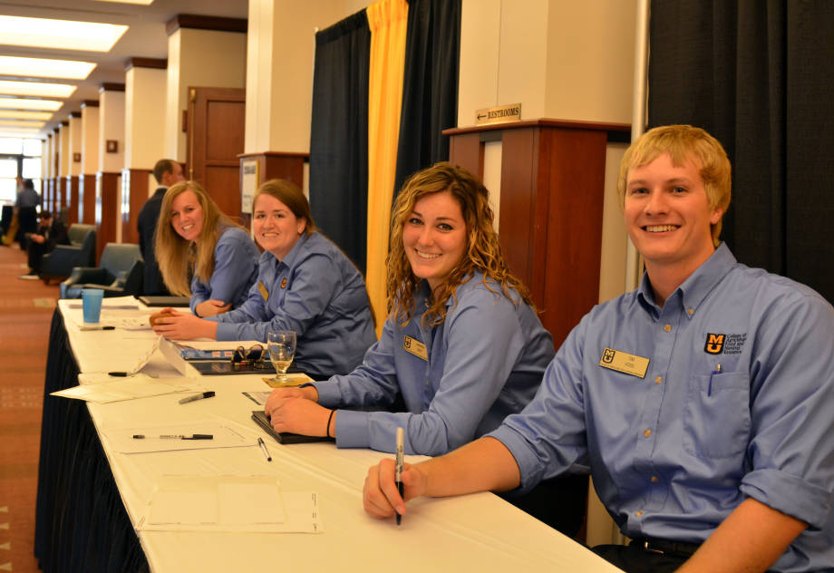 CAFNR Career Services student assistants, from left, Ashley Hilltop, Mary Bonnette, Amanda Neff and Tim Voss, greet students at the CAFNR Career Fair, Wednesday, Oct. 3.
