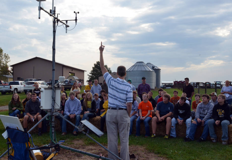 Pat Guinan, extension assistant professor of climatology, talks to students FFA students about how the weather station works at Forage Systems Research Center's annual Field Day, Tuesday, Sept. 25.
