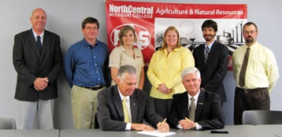Seated front from left, Neil Nuttall (NCMC president) and Bryan Garton (MU associate dean of Academic Programs). Standing from left, James Gardner (NCMC vice president of Instruction/Student Services); David Nowland (NCMC agriculture/natural resources instructor); Cara Fordyce (NCMC Student Senate president); Melissa Remley (MU assistant professor of Plant Sciences); Matt Pourney (MU director of Study Abroad Program); and Rustin Jumps (NCMC agriculture/natural resources instructor). Representatives of North Central Missouri College (NCMC) in Trenton and the College of Agriculture, Food and Natural Resources (CAFNR) signed new Articulation Agreements in September. By establishing these agreements, NCMC and MU have expressed a shared commitment to increasing opportunities for student access to and success in higher education.  This is done by clarifying transfer policies and procedures which will assure articulation between programs, assisting students in making a seamless transfer from an Associate of Arts Degree at North Central Missouri College to a baccalaureate degree in Agricultural Education, Agricultural Systems Management or Plant Science at the University of Missouri.