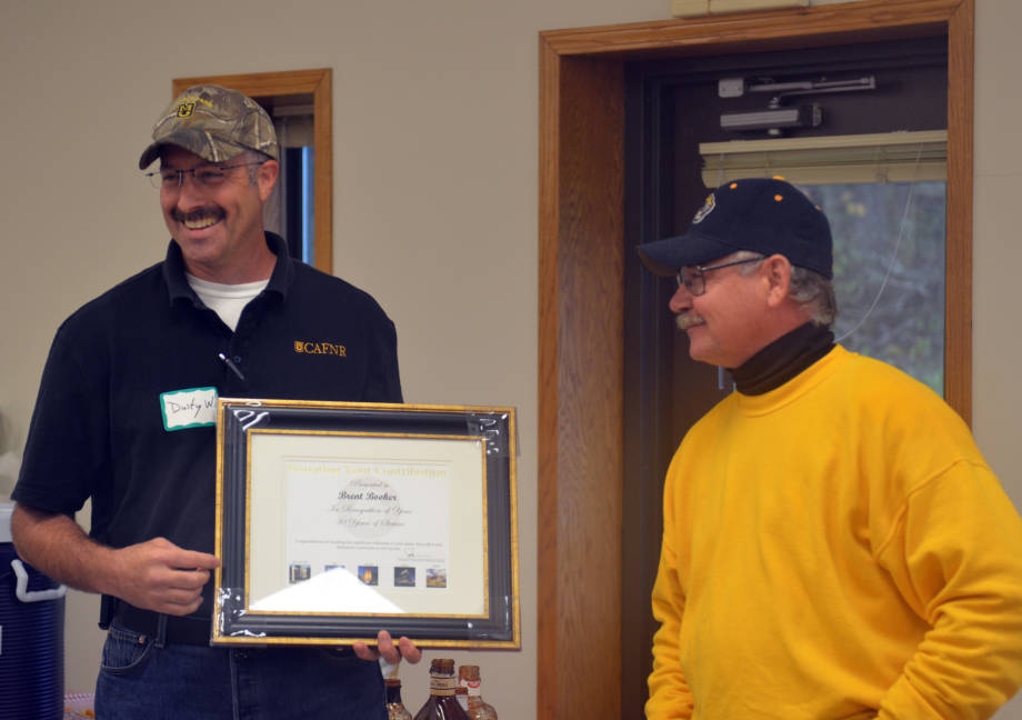 Brent Booker, farm manager at Wurdack Research Center, is recognized for 30 years of service with the University of Missouri. Dusty Walter, superintendent of Wurdack Research Center, presented the award to Booker at the conclusion of Wurdack's annual Field Day, Friday, Oct. 5.