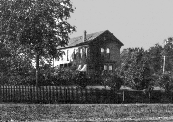 The Experiment Station Building in 1896, then at the northwest corner of East Campus. Porter oversaw its restoration, blunting criticism of decrepit facilities of the College of Agriculture. Courtesy University Archives.