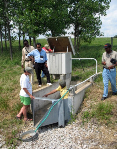 Ranjith Udawatta, associate professor in Soil, Environmental and Atmospheric Sciences, demonstrates riparian buffer / water quality runoff collection equipment at the Horticulture and Agroforestry Research Center (HARC) in New Franklin, Mo.