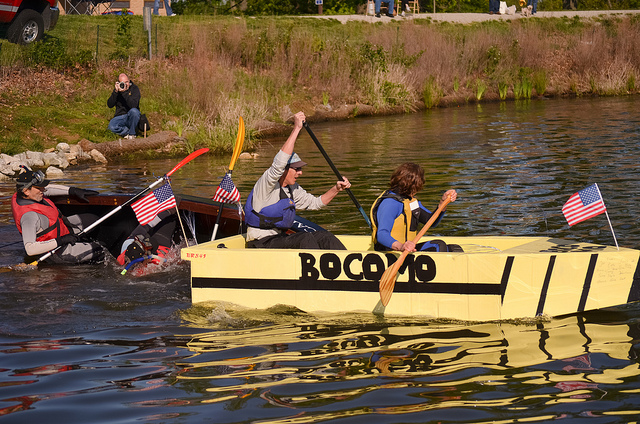 A boat sponsored by Boone County pulls ahead of the vessel commanded by Tom Payne, vice chancellor and CAFNR dean.