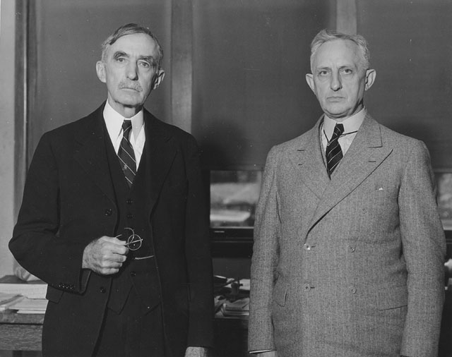 An unsmiling Mumford with an equally unsmiling Secretary of Agriculture at Mumford's retirement celebration. Courtesy University of Missouri Archives.