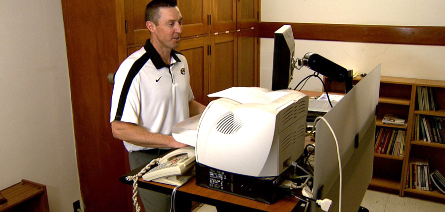 Steve Ball, MU Extension state fitness specialist, works at his treadmill desk. Courtesy MU Extension.