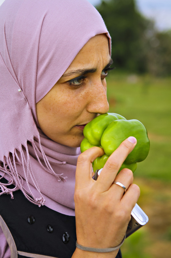 Sihem Khiri, an engineer with the Algerian National Institute of Agriculture Research, stopped to smell a freshly picked green pepper at Peach Tree Farms.
