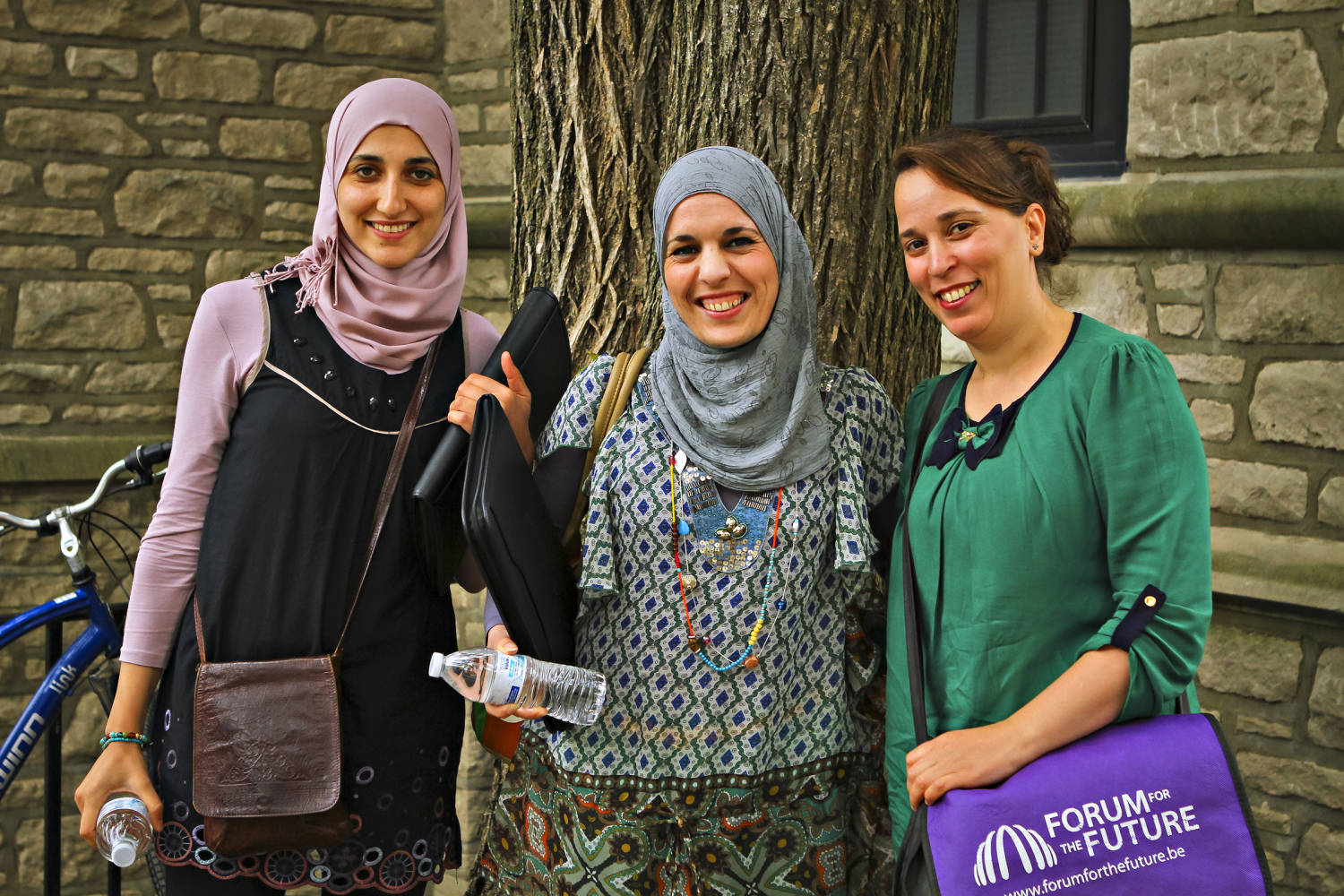 From left, Sihem Khiri, Souad Mammou and Louiza Chekmam pose for a group picture outside Gentry Hall on the University of Missouri campus. As part of an Cochran Fellowship Program, the three women from Algeria visited Missouri to learn about agricultural markets.