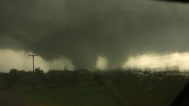 A photo of the Tushka, Oklahoma tornado, an EF3 which struck the town on April 14, 2011 during the Mid-April 2011 tornado outbreak. Courtesy Gabe Garfield and Marc Austin.