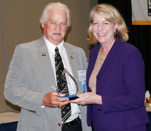Hitzhusen accepts award from Gail Vasterling, director of the department