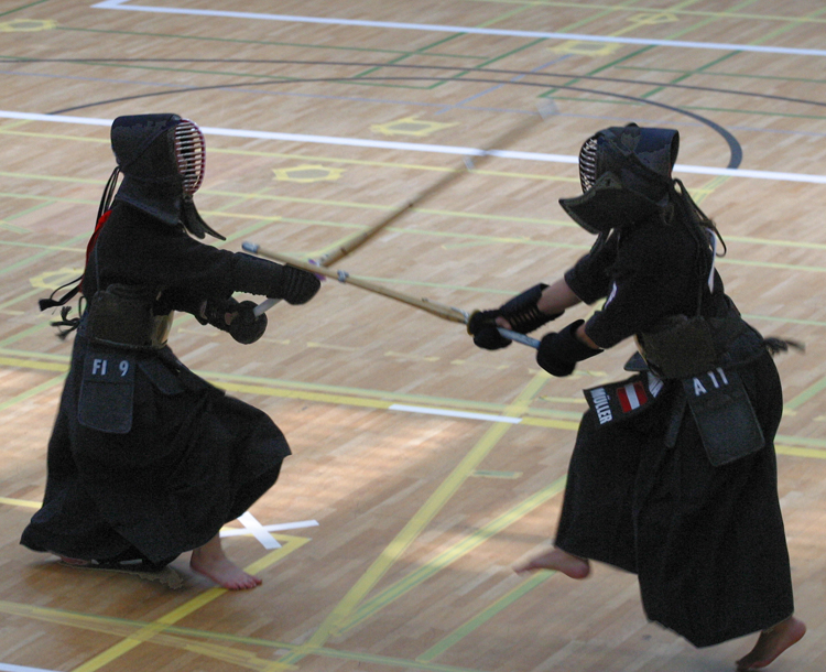 The kendōka at the right scores a point on his opponent's kote at the European Kendo Championships in Bern, Switzerland.  Courtesy Harald Hofer.