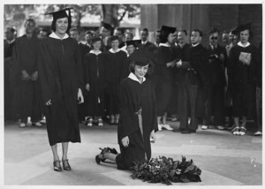 Two students from 1939 graduating senior class laying a wreath on Memorial Tower's arcade floor in honor of fallen World War I soldiers and sailors. Many members of this class would fight and die in World War II. Courtesy University Archives.