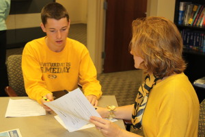 Career Service Director Stephanie Chipman helps a CAFNR student revise their resume in preparation for the Career Fair held last month