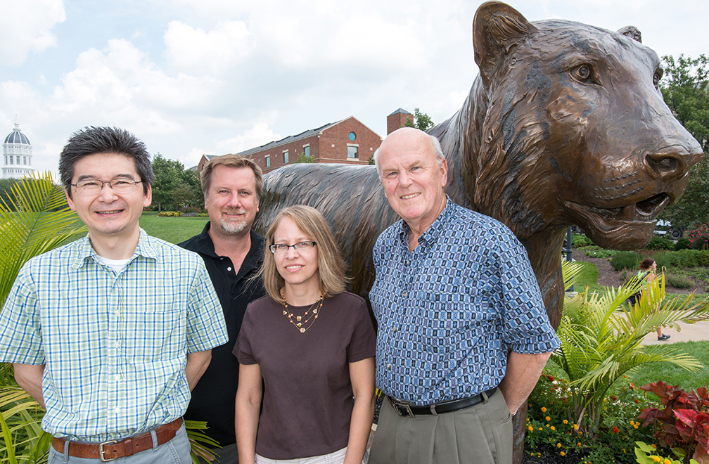 Toshihiko Ezashi (left), Danny Schust (middle), Laura Schulz (middle) and Michael Roberts (right) collaborate on new research to discover the causes of preeclampsia. Photo by Roger Meissen.