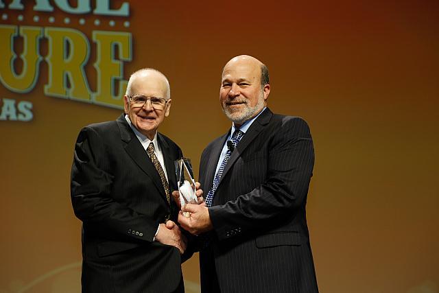 Abner Womack receives his award from AFBF President Bob Stallman. Courtesy American Farm Bureau Federation.