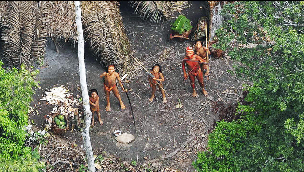 Members of an uncontacted tribe in the Brazilian state of Acre try to shoot a passing airplane with their bows and arrows.  Courtesy Government of Brazil.