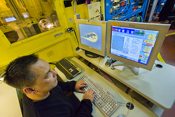 In California, an assistant loads MU crystals into the beamline.