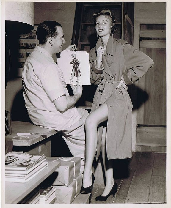 In a Chicago Sun-Times publicity shot, Caniff poses with a model who was allegedly the inspiration for the Miss Mizzou character. Caniff later claimed the inspiration was Marilyn Monroe, but was threatened with a lawsuit by that actress for infringement of copyright. Caniff later claimed Miss Mizzou was patterned after a showgirl in New York. Courtesy Chicago Sun-Times Archives.