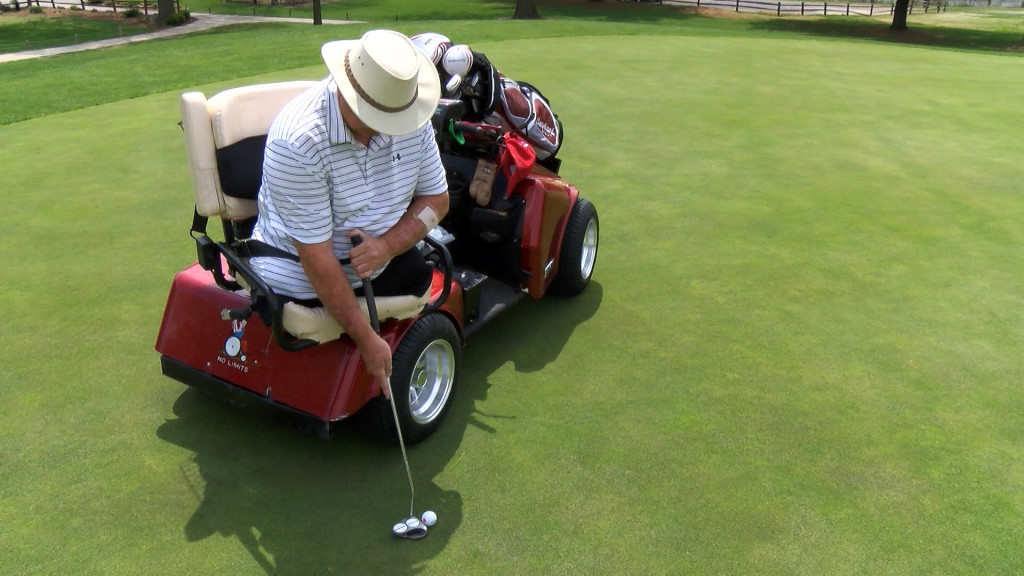 Vietnam veteran Gary York's single-rider cart is designed to drive onto greens and teeing grounds without damaging turf. Courtesy MU Extension.