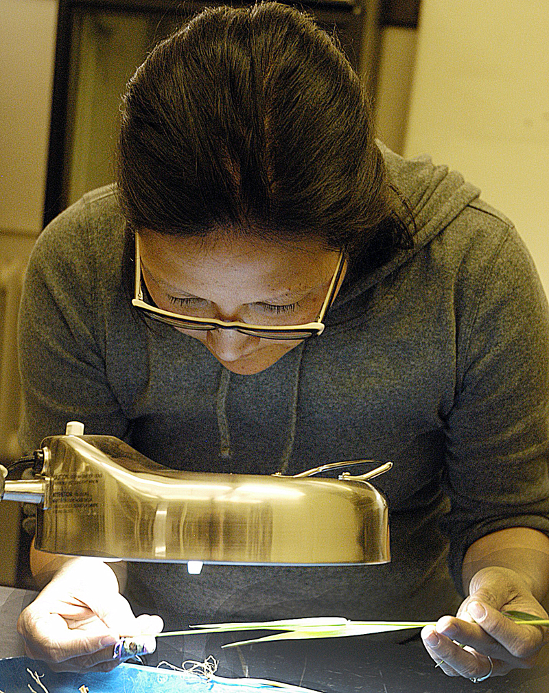 Patti Wallace examines a wheat sample at the MU Plant Diagnostic Clinic. The public clinic recently reopened on the MU campus.