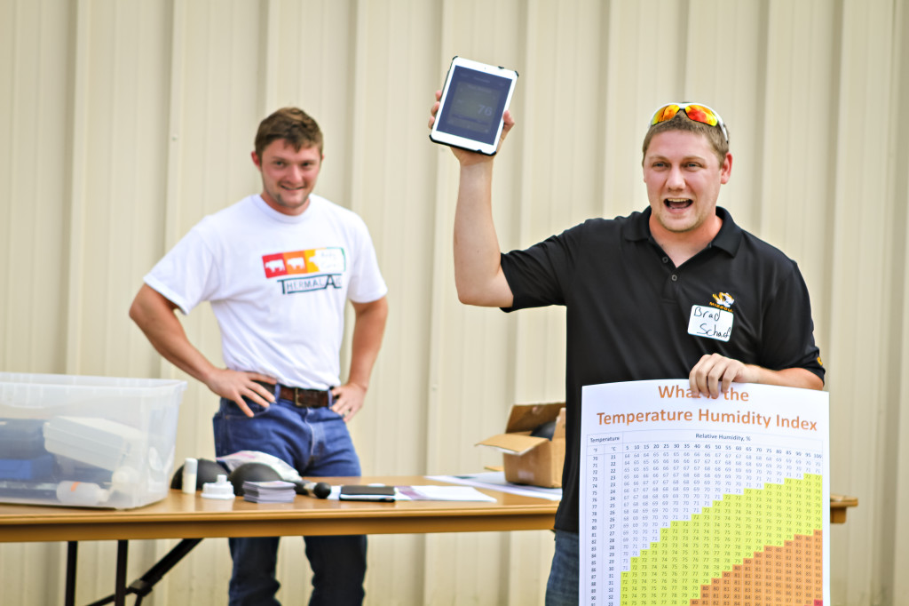 Brad Scharf, MU Post Doctoral Student, talks to the crowd about Thermal Aid. The new smart phone app from MU helps detect heat stress in livestock at the Wurdack Research Center Field Day last year.