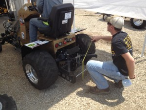 Team members prepare quarter scale tractors for competition against 26 other university teams.