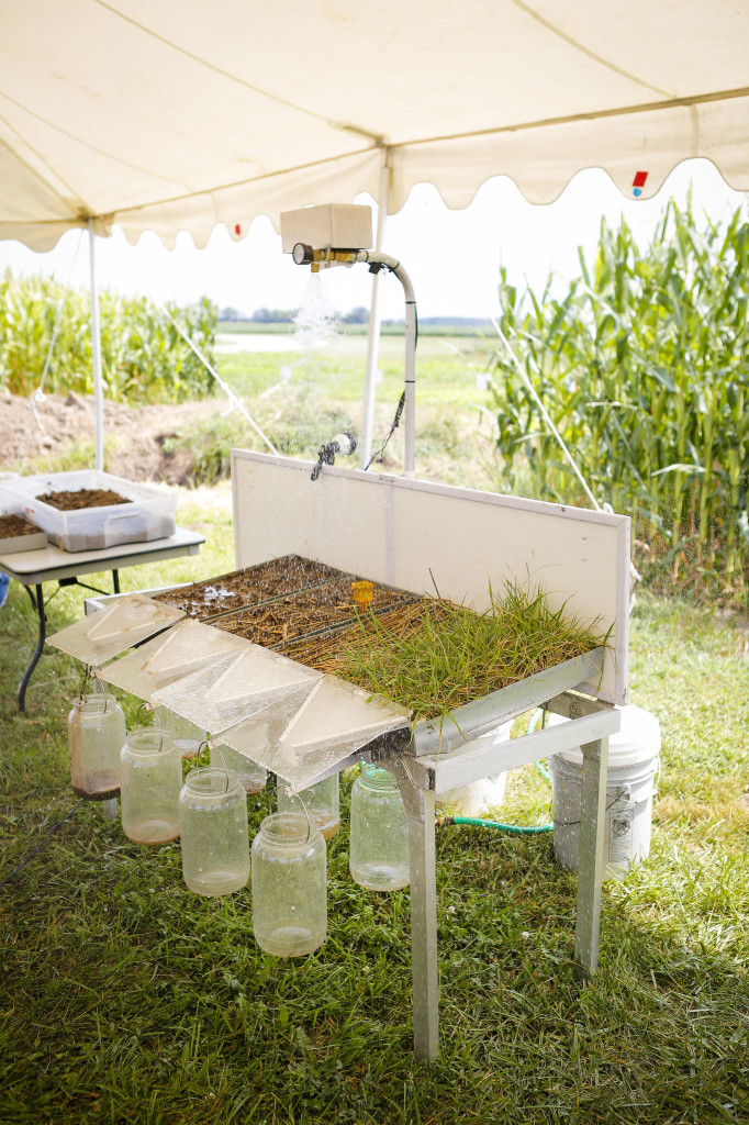 A demonstration with an erosion simulator that illustrates how much runoff happens from a conventional, no-till and cover crop system. The demo mimics a rain event over soil pans used with each system. As the water moves through the soil, it is collected in jars to give a visual representation of what is being lost due to erosion.