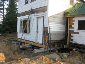 The house on jacks as renovations begin.