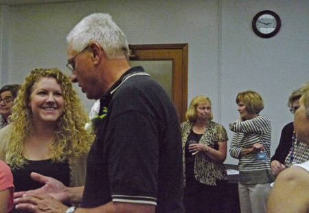 Dauve chats with Beth Nordwald, a former student who spoke at his reception.