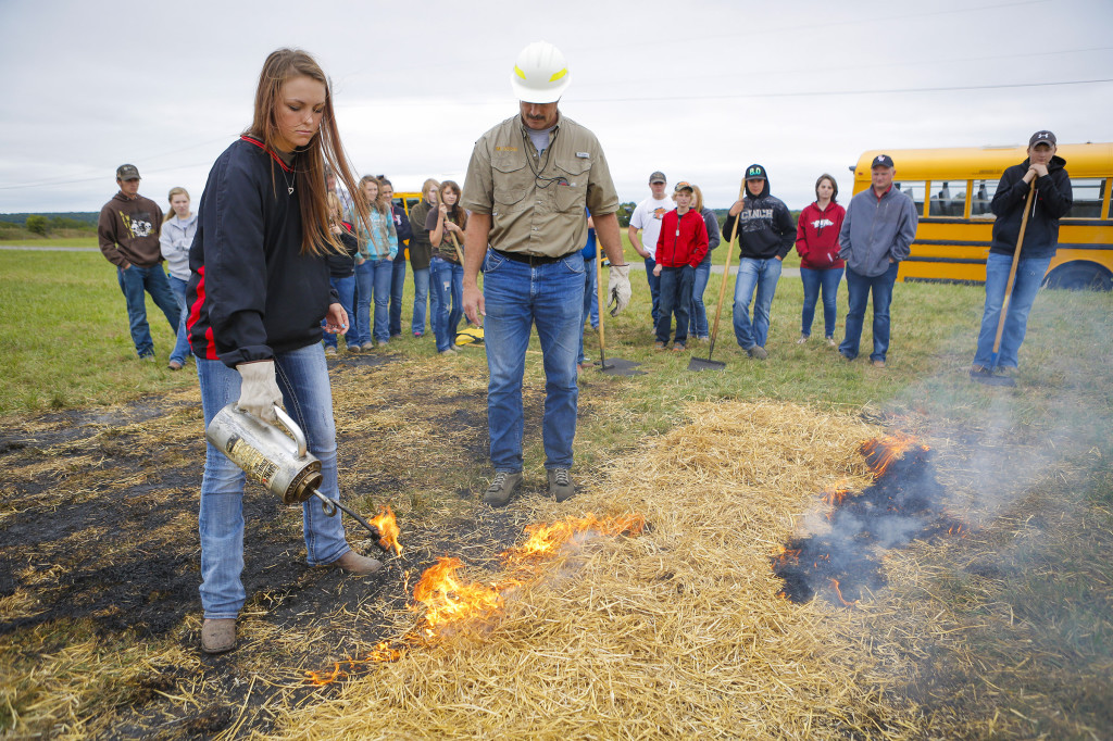 Dusty Walter, superintendent of Wurdack Research Center, spoke to students from Southwest High School about the importance of fire and how it can be used in land management strategies. He demonstrated how quickly a fire can spread, but how certain tools and practices can easily contain a controlled burn.
