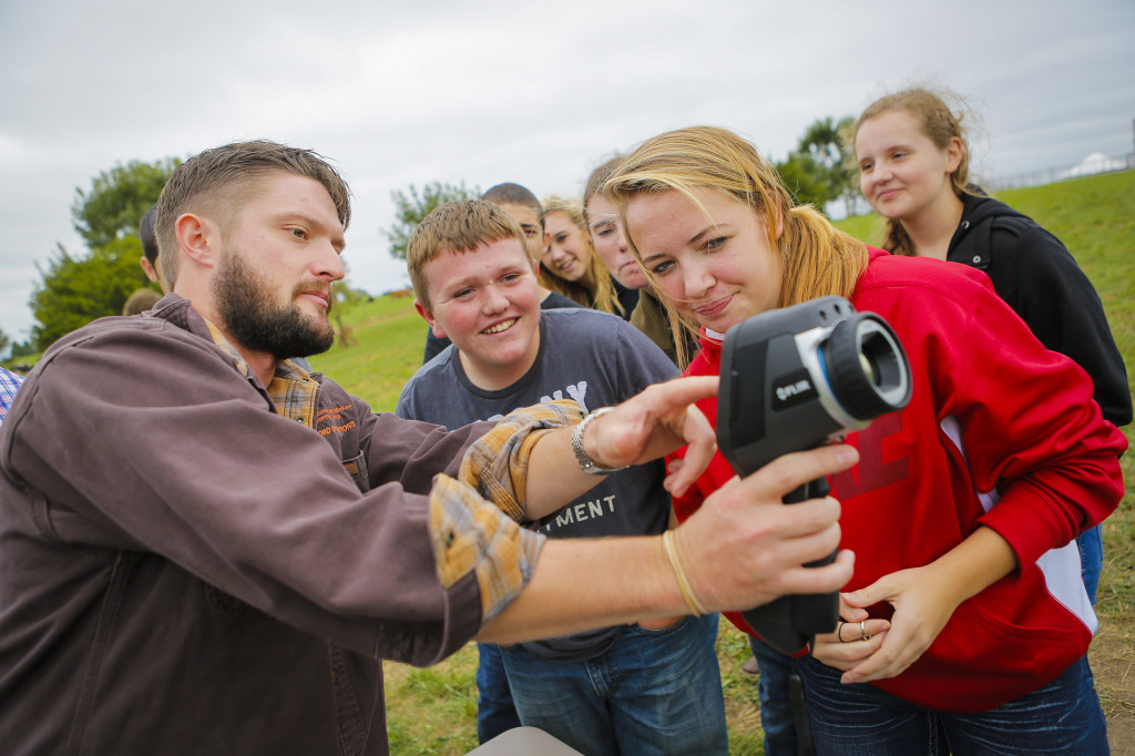 MU Graduate Student Andrew Curtis shared with students from Miller High School the new Thermail Aid smartphone application from CAFNR. The app is used to detect heat stress in livestock. He shared tools used to help monitor livestock and other heat-monitoring devices used.
