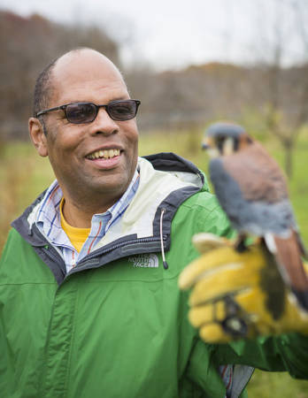 Charles Nilon and one of the species he studied in St. Louis, the American Kestrel.
