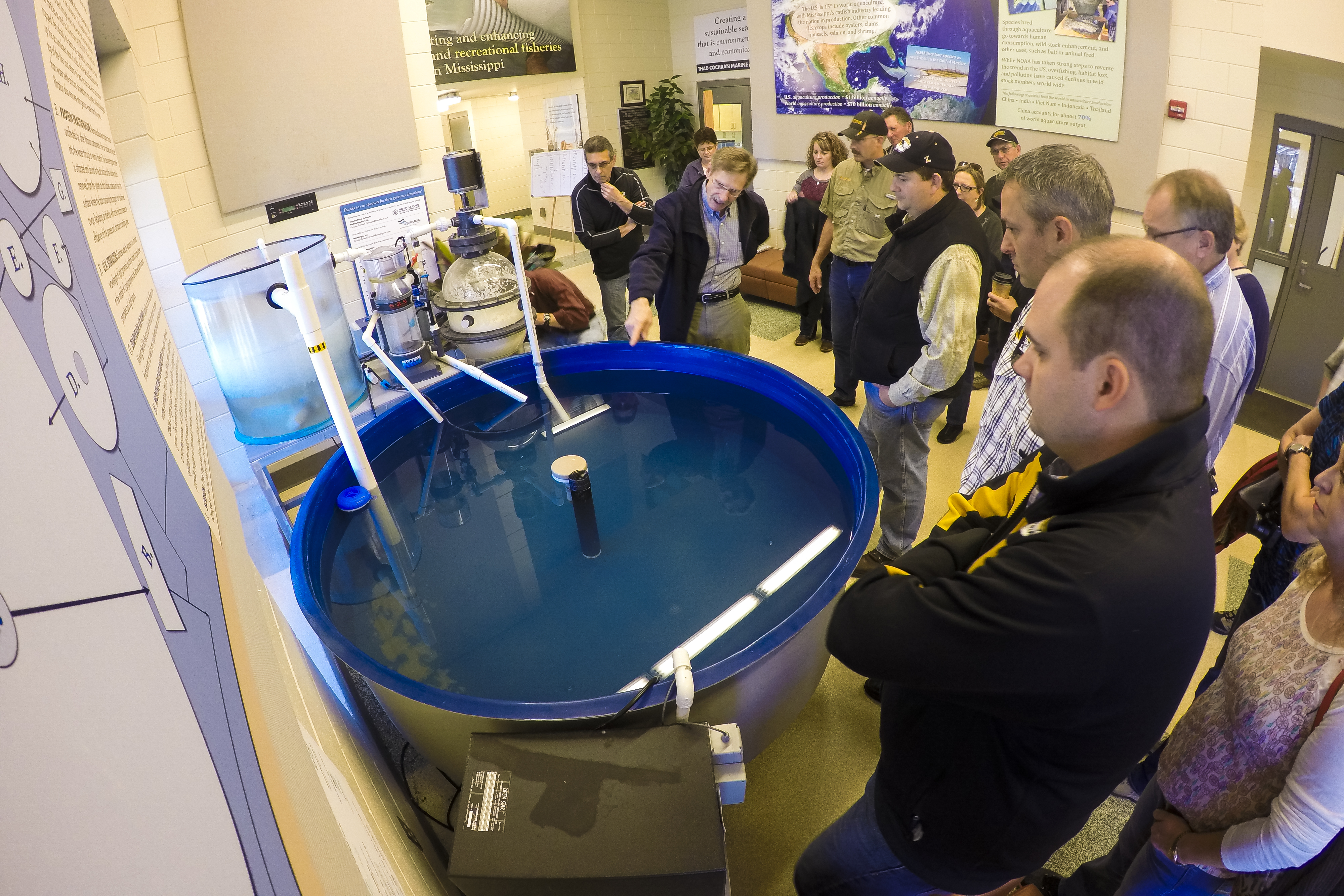 The group toured the Thad Cochran Marine Aquaculture Center on Dec. 2. Stops included overiews of the aquaculture studies, seatrout restocking efforts and shrimp farming labs.