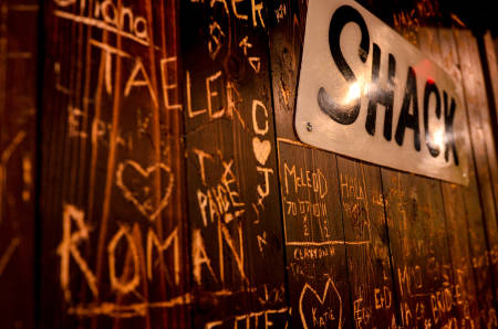 The Shack lounge area recaptures the nostalgia of a beloved hangout, complete with portions of actual booths from the original, as well as photos and stories.