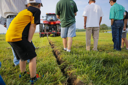 Research Professor Kelly Nelson shows a recent study looking at the effects of subsurface drip irrigation systems for corn and soybeans at Greenley Research Center's 2014 Field Day.