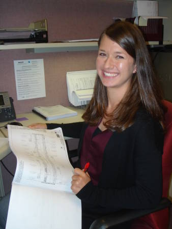 Liz Leingang looks over plans at her summer internship with the Missouri Department of Transportation.