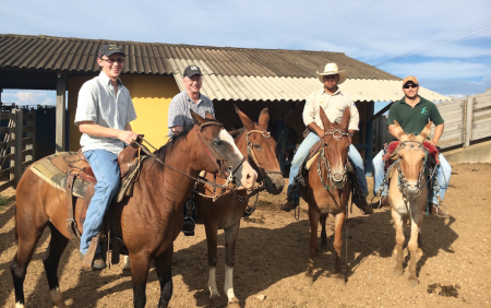 Ky Pohler, left, went to Brazil several times to work on research as a graduate student. In this photo taken in Brazil, next to Pohler's left is Mike Smith. The two did research on cattle together in Brazil that helped launch his current position as an assistant professor at the University of Tennessee.