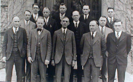 This photo of the faculty and administration of the Department of Animal Husbandry (later to be called Animal Sciences). Among those pictured is Frederick Mumford (first row, middle), Fred McKenzie (first row, far right) and L.E. Casida (back row, far left).