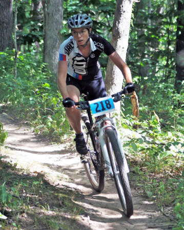 Lisa Webb, shown her in a a mountain biking race, takes part in about 10 competitive events a year. Photo courtesy of Lisa Webb.