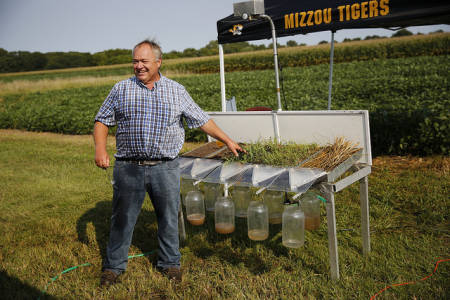 Tim Reinbott gave a soil water infiltration demonstration during the annual Hundley-Whaley Research Center Field Day that took place Wednesday, Aug. 26.