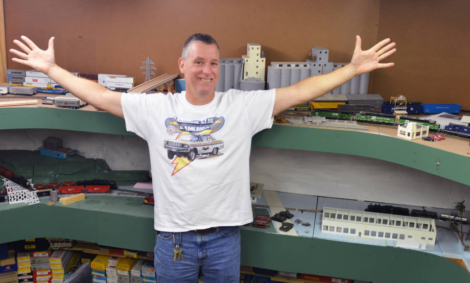 Jim Reese showing off his model railroad colection.