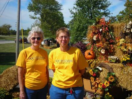 Volunteer Louise Bullock (left) and Mary Ann Gowdy, teaching assistant professor of plant sciences and Tiger Garden advisor, help out at the flower shop's booth at a South Farm Showcase. Photo courtesy of Rebecca Melton.