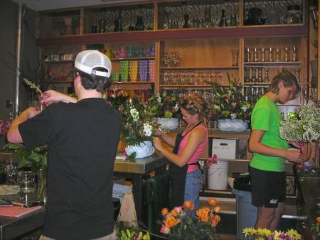 Students and former manager Kim Martin (center) keep busy in the store.